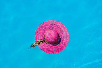 hat in the swimming pool