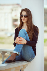 Stylish young woman in glasses