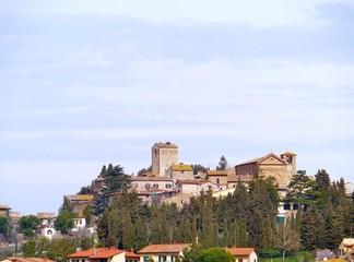 The city Orvieto rising above defensive walls