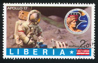 Apollo badge and astronaut on moon