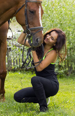Woman caresing horse