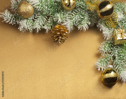 Christmas decorations over golden satin