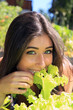 Beautiful girl eating lettuce