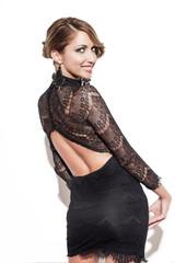 Sexy woman looking back at wall