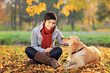 Beautiful young woman in a park with a dog