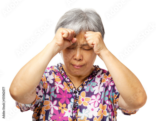 Mature asian woman serious headache