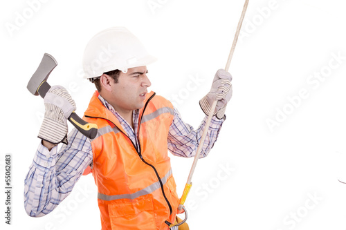 adult man wearing safety equipment descending a rope