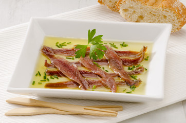 Spanish Cuisine. Marinated anchovies. Anchoas en aceite.