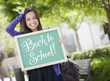 Mixed Race Female Student Holding Chalkboard With Back To School