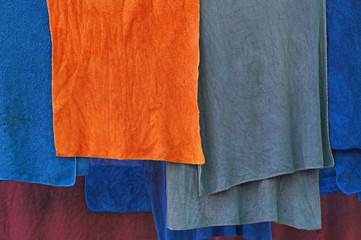 colorful microfiber cloths hanged on clothesline