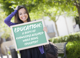 Mixed Race Female Student Holding Chalkboard With Education and