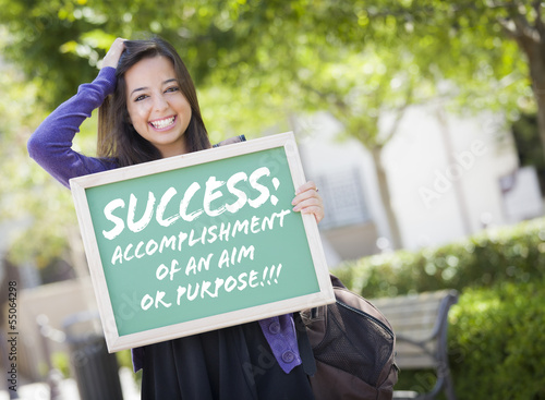 Mixed Race Female Student Holding Chalkboard With Success and De