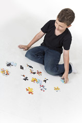 Young boy is determined to solve a puzzle