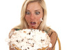 Woman holding pie by face messy