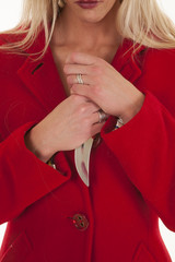 Woman red coat hold knife by chest