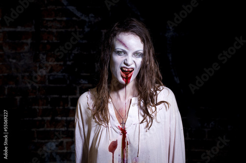 Bloody and scary looking zombie woman
