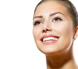 Teeth Whitening. Beautiful Smiling Young Woman Portrait