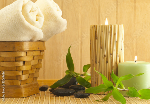 Spa composition with bamboo plant  and black stones