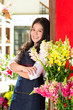 Asian Chinese Sales woman in a flower shop