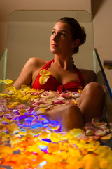 Woman bathing in spa with color therapy