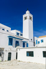 Sidi Bou Said tower in Tunisia, streets and buildings near town