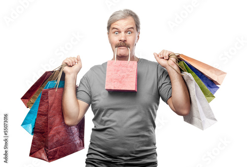 surprised mature man holding shopping bags isolated on white bac