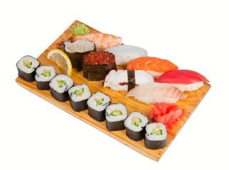 Sushi set on board isolated on white