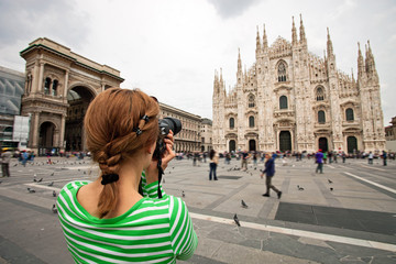 Young woman taking picture of Duomo di Milano