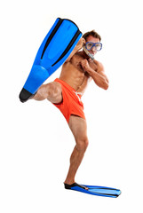 Caucasian swimmer wearing mask, snorkel and flippers kicking