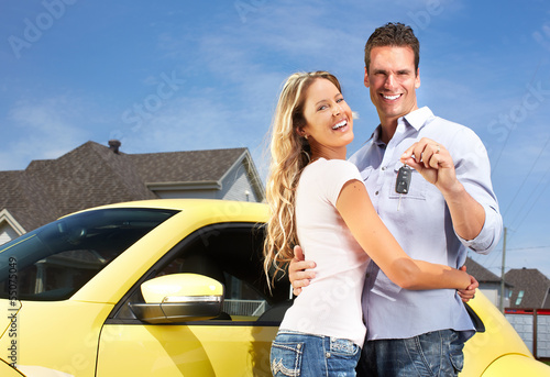 Couple with a car key.