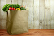 Bag of Grocery Produce Items on a Wooden Plank - 55076043