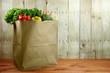 Leinwandbild Motiv Bag of Grocery Produce Items on a Wooden Plank