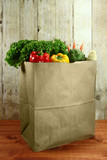 Bag of Grocery Produce Items on a Wooden Plank