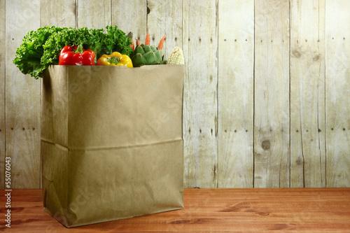 Leinwanddruck Bild Bag of Grocery Produce Items on a Wooden Plank