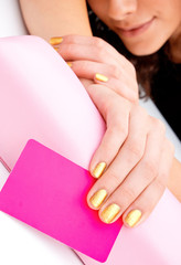 woman hand with business card for beauty salon