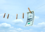money with wooden clothespin on clothes line