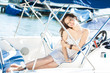 Attractive young woman on vacation on yacht summer cruise