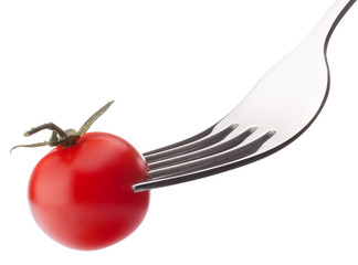 Cherry tomato on fork isolated on white background cutout. Healt