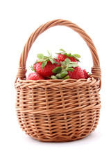 wicker basket with strawberries isolated on white