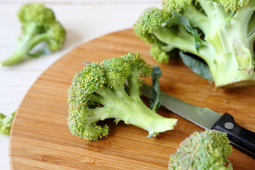 fresh broccoli on a cutting board and knife