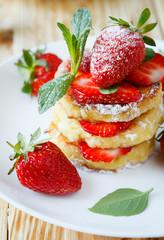 pancakes with fruit, ripe strawberry
