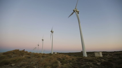 wind turbines generating clean power at sunset