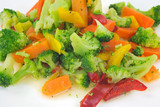Healthy vegetables on plate in oil