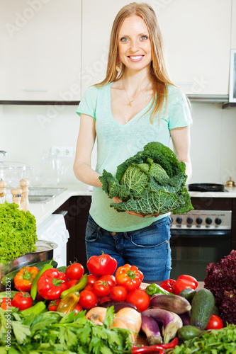 happy beautiful woman with raw vegetables