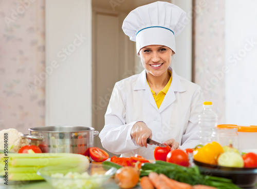 cook works with vegetables at  kitchen