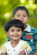 Cute indian kids(brother and sister) having good time in a park