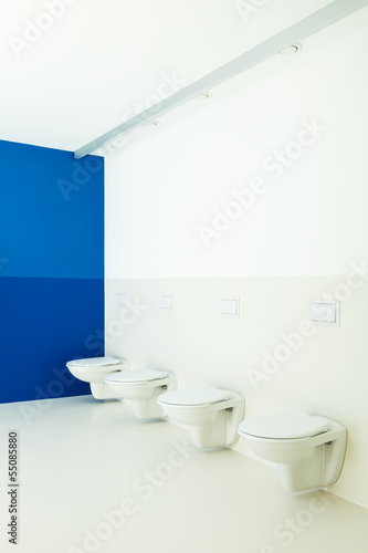 new architecture, public bathroom, toilets in a row