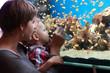 Mother and son at aquarium