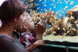 Mother and son at aquarium