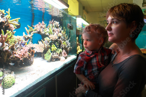 Mother with toddler at aquarium
